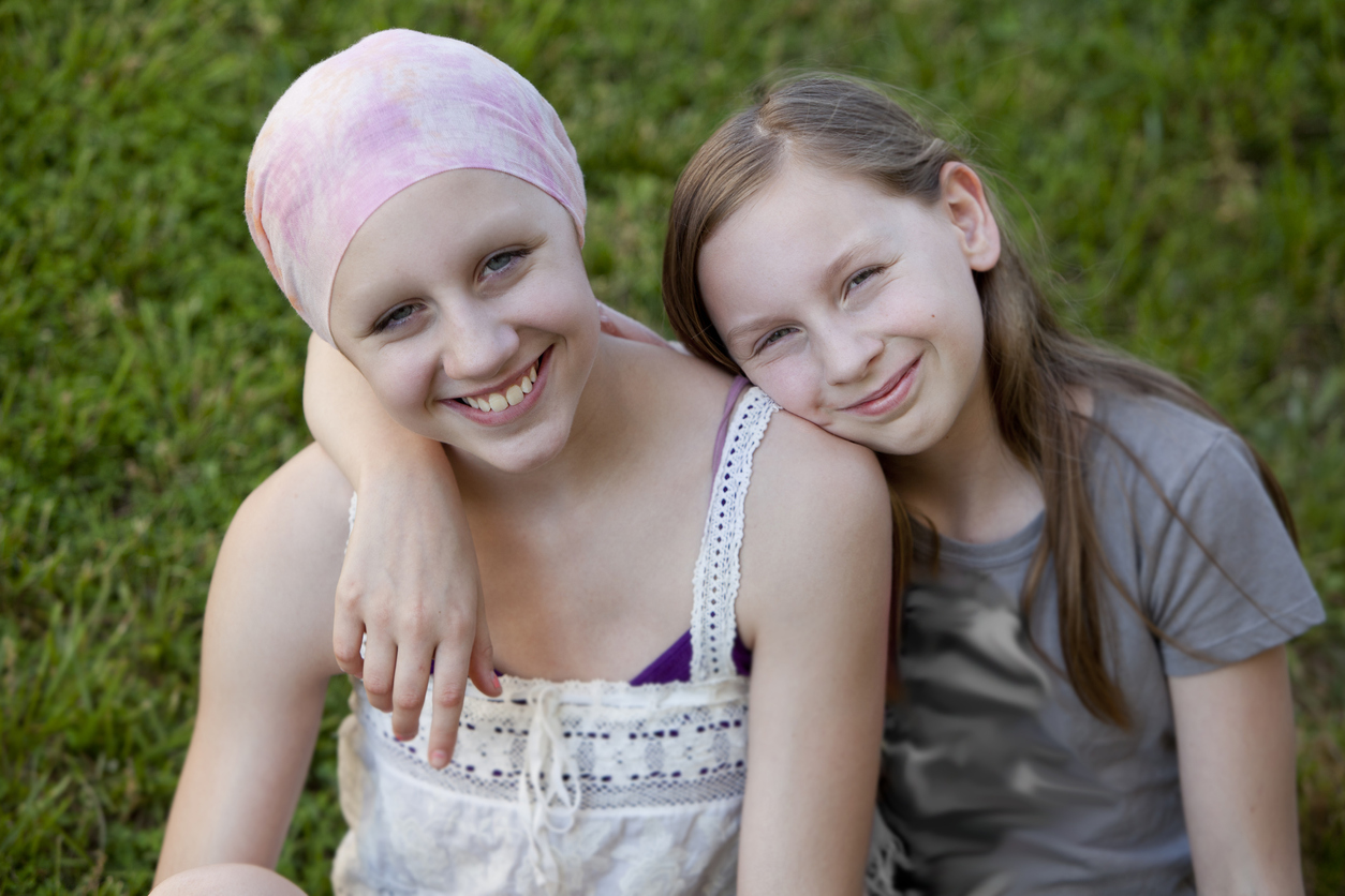 Girl with cancer and loving sister